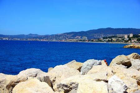 Beautiful rock beach in Cannes, France photo