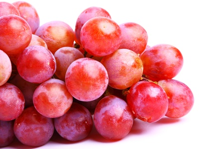 Delicious branch of red grapes isolated on white background