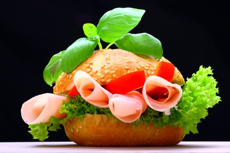 Delicious roll full of ham, paprika and lettuce photo