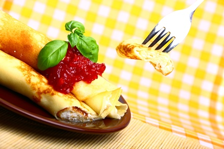 Delicious sweet pancake with cottage cheese and cherry jam photo