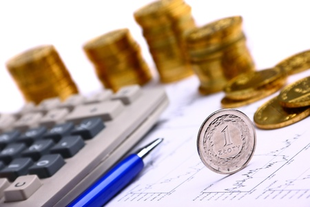 Money coins, calculator on the business stock charts Stock Photo