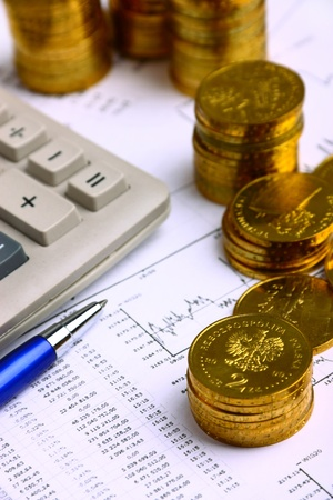 Money coins, calculator on the businness stock charts photo