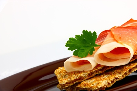 Delicious rolled smoked ham on wholemeal bread photo