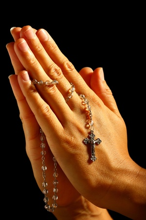 Christian human praying with rosary in hands Stock Photo - 12805903