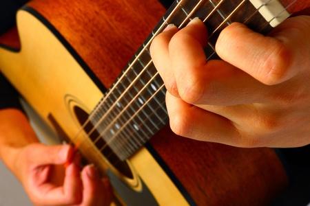 Closeup view of playing classic spanish guitar Stock Photo