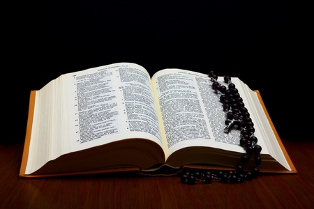 Christian Holy Bible with Cross on rosary photo