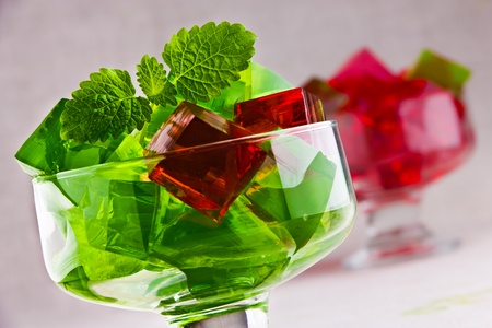 Delicious sweet jelly dessert in elegant goblet photo