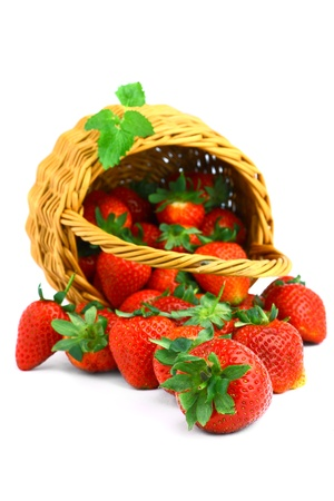Delicious strawberries in basket isolated on white Stock Photo