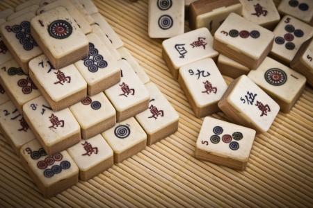 mahjong: Old chinese game mahjong on bamboo mat background