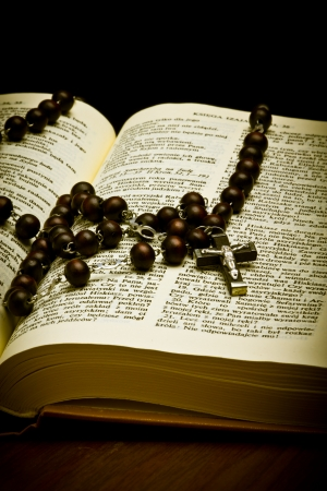 Christian Holy Bible with Crucifix on rosary photo