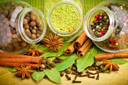 Pack of several spices and herbs in glass jars photo