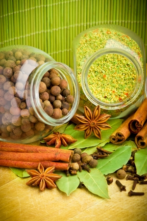 Pack of several spices and herbs in glass jars Stock Photo