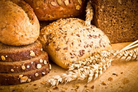 Collection of baked bread on wooden background Stock Photo