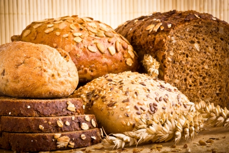 Collection of baked bread on wooden background photo