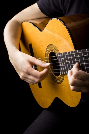 strat: Closeup view of playing classic spanish guitar Stock Photo