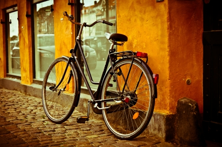 Classic vintage retro city bicycle in Copenhagen, Denmark photo