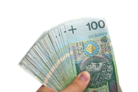 View of hand holding several polish one hundred banknotes photo