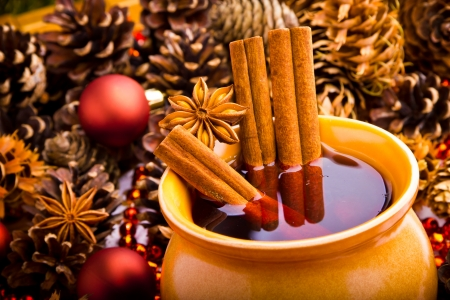 Mulled wine in brown jug with cinnamon and anise photo