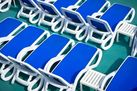 Close up view of blue deck chairs photo