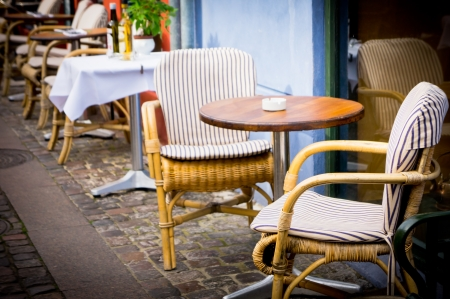 round chairs: Vintage old fashioned cafe chairs with table in Copenhagen, Denmark