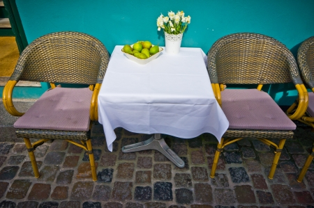 Vintage old fashioned cafe chairs with table in Copenhagen, Denmark photo