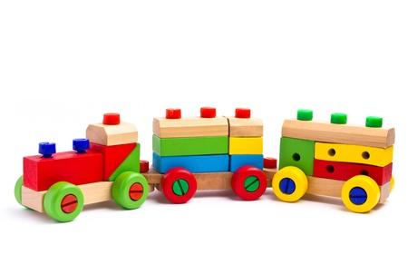 juguetes de madera: Tren de juguete de madera de colores sobre fondo blanco Foto de archivo