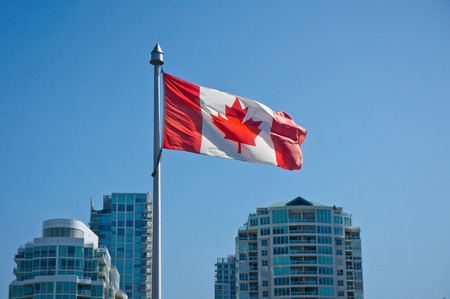 canadian flag: Canadian flag on the Vancouver skyscrapers background