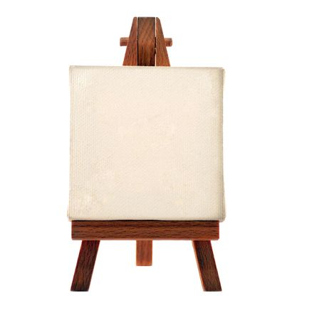 a customizable blank canvas on a wooden tripod photo