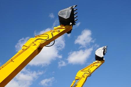 Bulldozer shovel opposite blue sky  photo