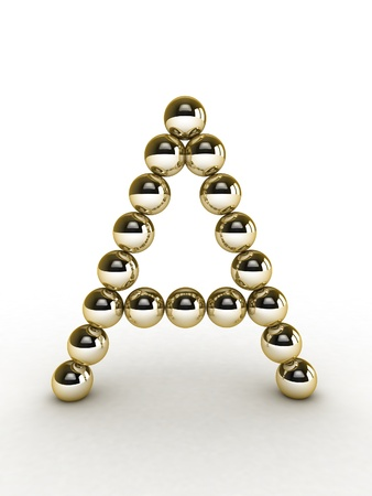 3d alphabet of gold beads. photo