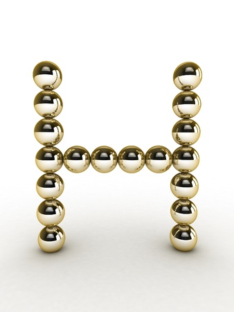 3d alphabet of gold beads. photo