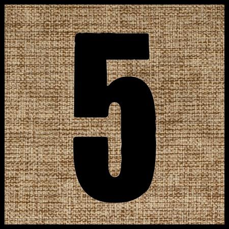 teclado numerico: el número cinco de la tela. Foto de archivo