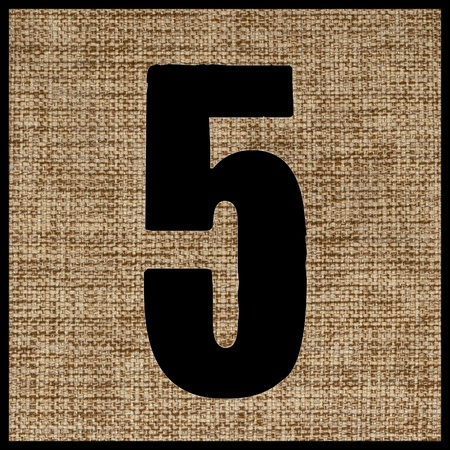 numeric: number five on the fabric. Stock Photo
