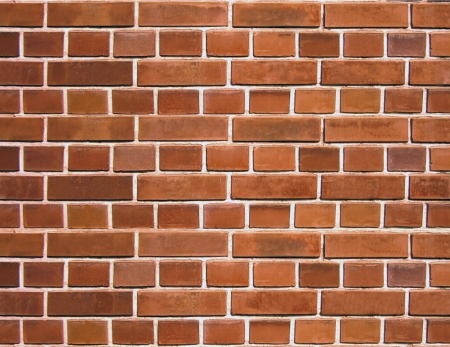 closeup of a brick wall with red bricks - texture background photo