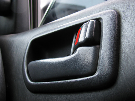 Door handle with the latch in the car photo