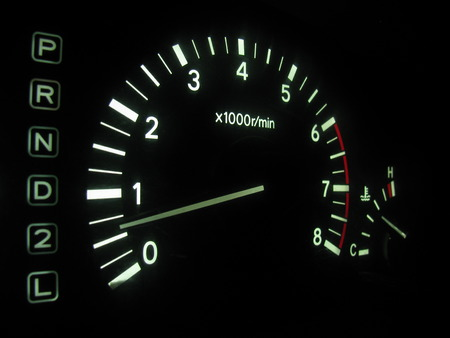 The tachometer on the instrument panel in the car photo