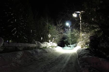 illuminate: Lights illuminate the road in the village