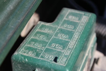 fuse box: The fuse box under the hood in the car Stock Photo