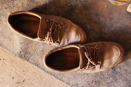 walk in closet: Old worn beige boots on the floor