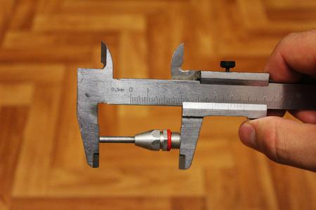 compresor: Boquilla en el vernier medición compresor Foto de archivo