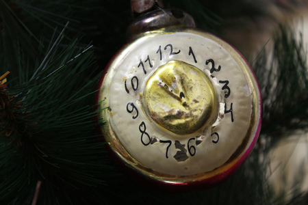 12 oclock: Toy on the Christmas tree - the old clock