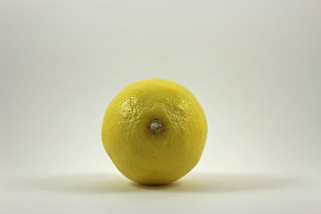 acidic: Yellow lemon on white background