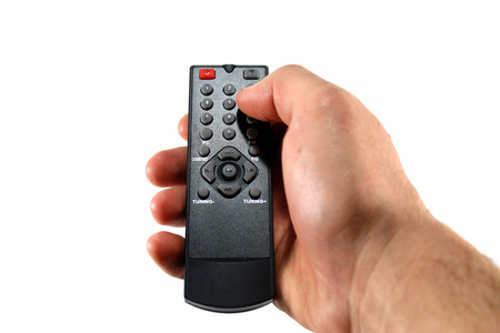 human hands: Hand with remote control on white background