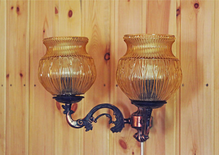 illuminator: Lamp on a wooden wall in the house