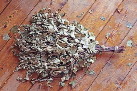 vaporarium: Bath broom on a wooden background Stock Photo
