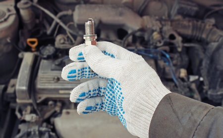 plug in: A new spark plug in hand