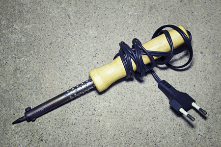 brazing: Soldering iron on a gray background