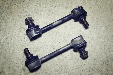 stabilizer: Old worn links stabilizer on a gray background Stock Photo