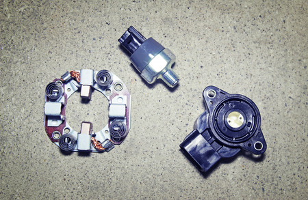 transducer: Car parts on a gray background