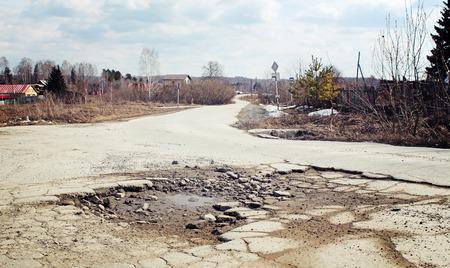 suburban: Large pit on the suburban road